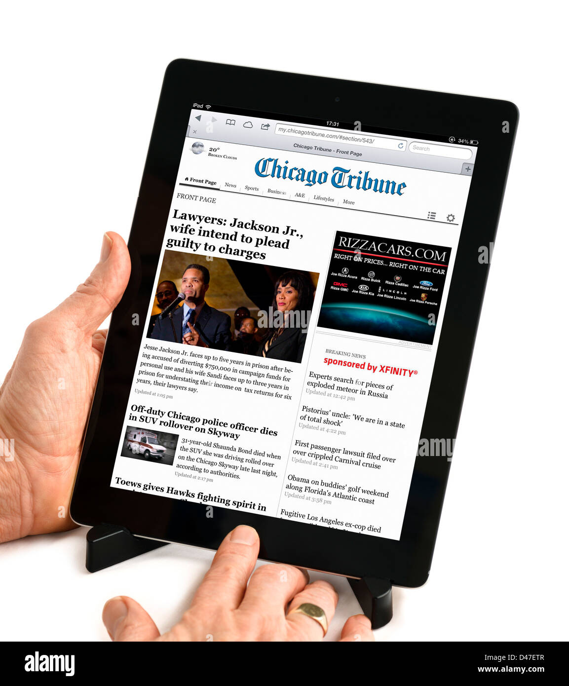 Reading the online edition of the Chicago Tribune on a 4th generation Apple iPad, USA - Stock Image
