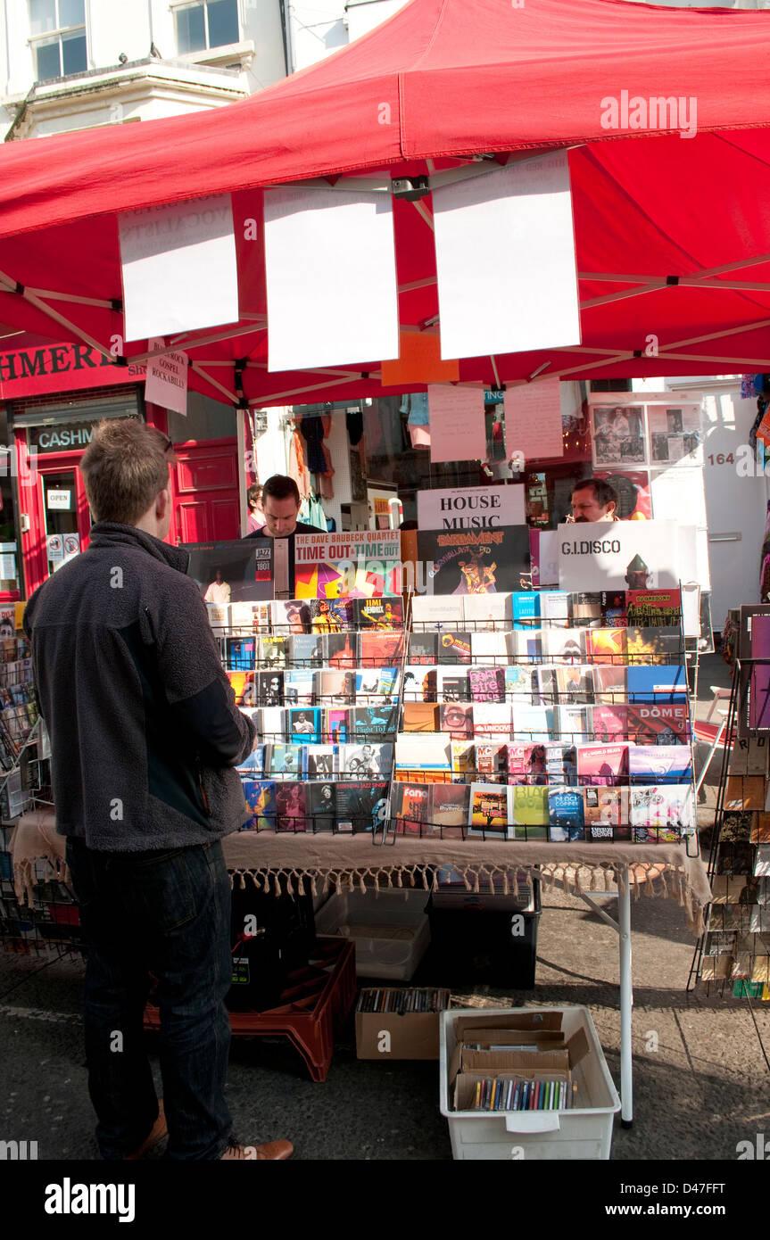 Music CDs stall, Portobello Road market, Notting Hill, London, UK - Stock Image