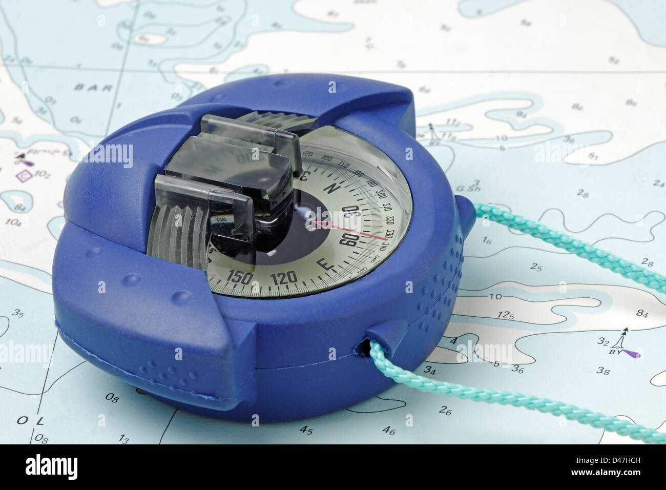 A marine hand-bearing compass on an old nautical chart - (chart is