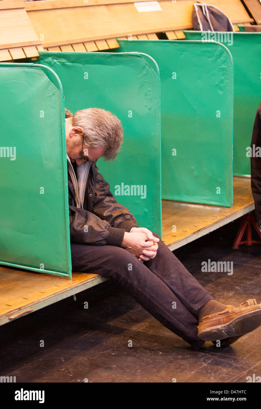 NEC, Birmingham, UK. 7th March 2103. Dog tired, an owner taking a nap at Crufts Credit:  Chris Gibson / Alamy Live - Stock Image