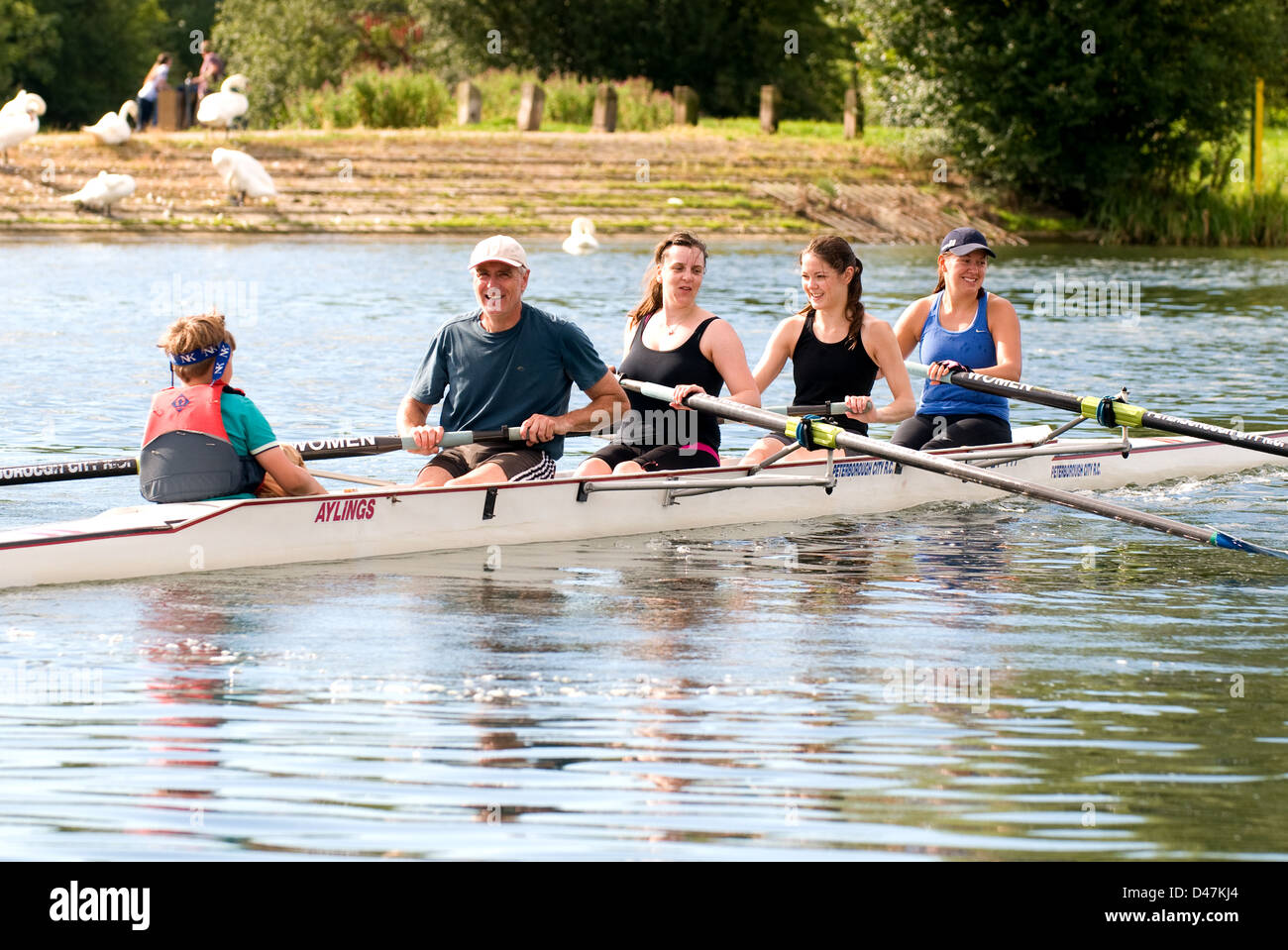 Mixed coxed four out on a training row - coach is in the stroke seat. - Stock Image