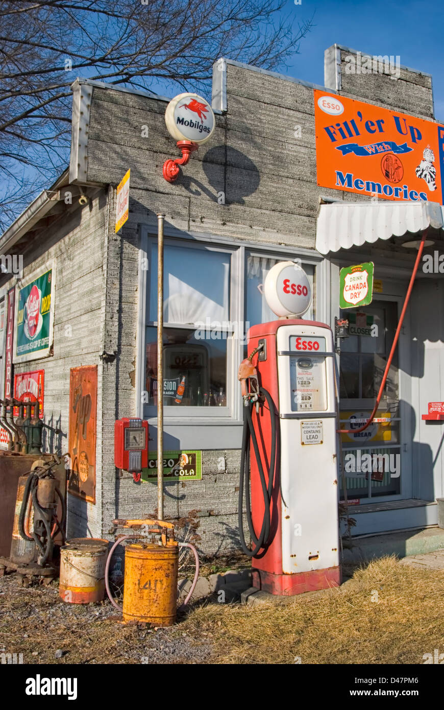 Gas station stuff and Esso gas pump at a country store, with other old fashioned Americana and memorabilia. - Stock Image