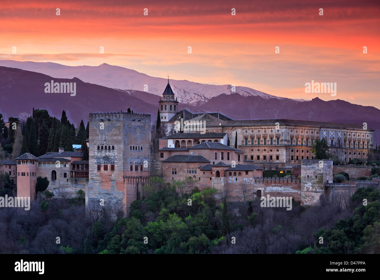 The Alhambra and snow-covered Sierra Nevada (Snowy Range), Granada, Spain - Stock Image