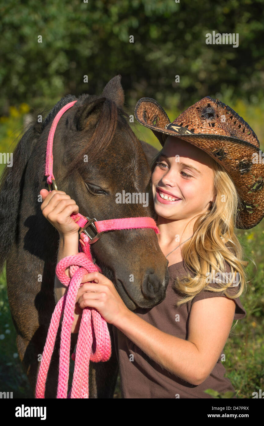 Young Girl Pink Cowboy Hat Stock Photos   Young Girl Pink Cowboy Hat ... 40bd621c82fc