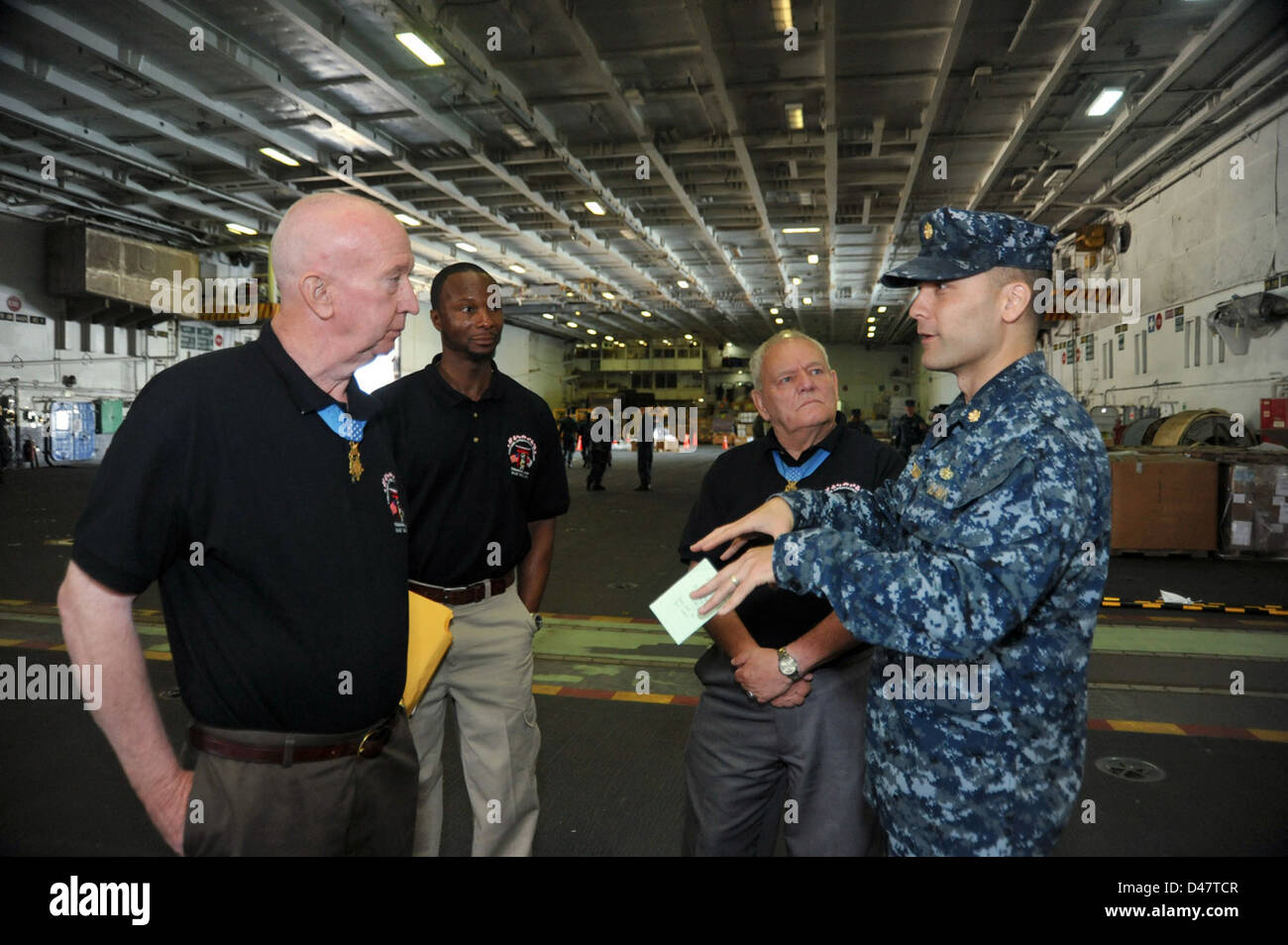 Medal of Honor recipients former U.S. Army Staff Sergeant Don Jenkins, left, and retired U.S. Army Sergeant Major Kenneth Stumpf tour the Japan-based aircraft carrier USS George Washington. Stock Photo