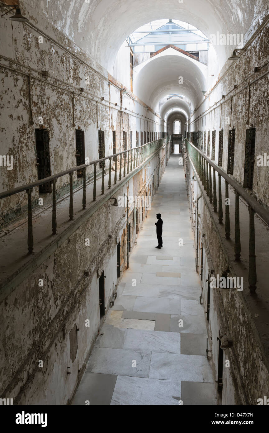 Prison cellblock from high angle view with one unrecognizable distant figure, Eastern State Penitentiary, Philadelphia, - Stock Image