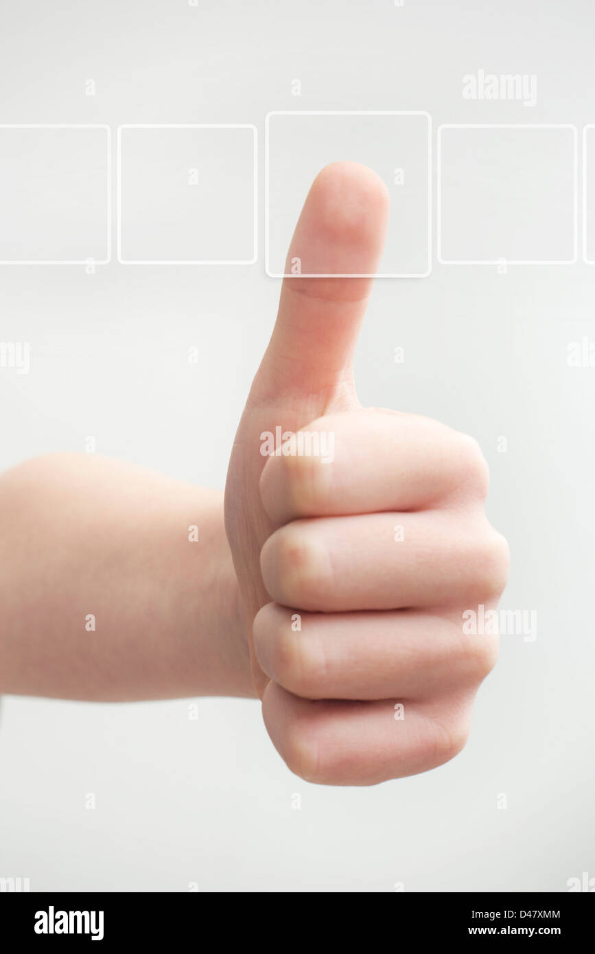 Thumb finger pushing transparent virtual button frame on light background - Stock Image
