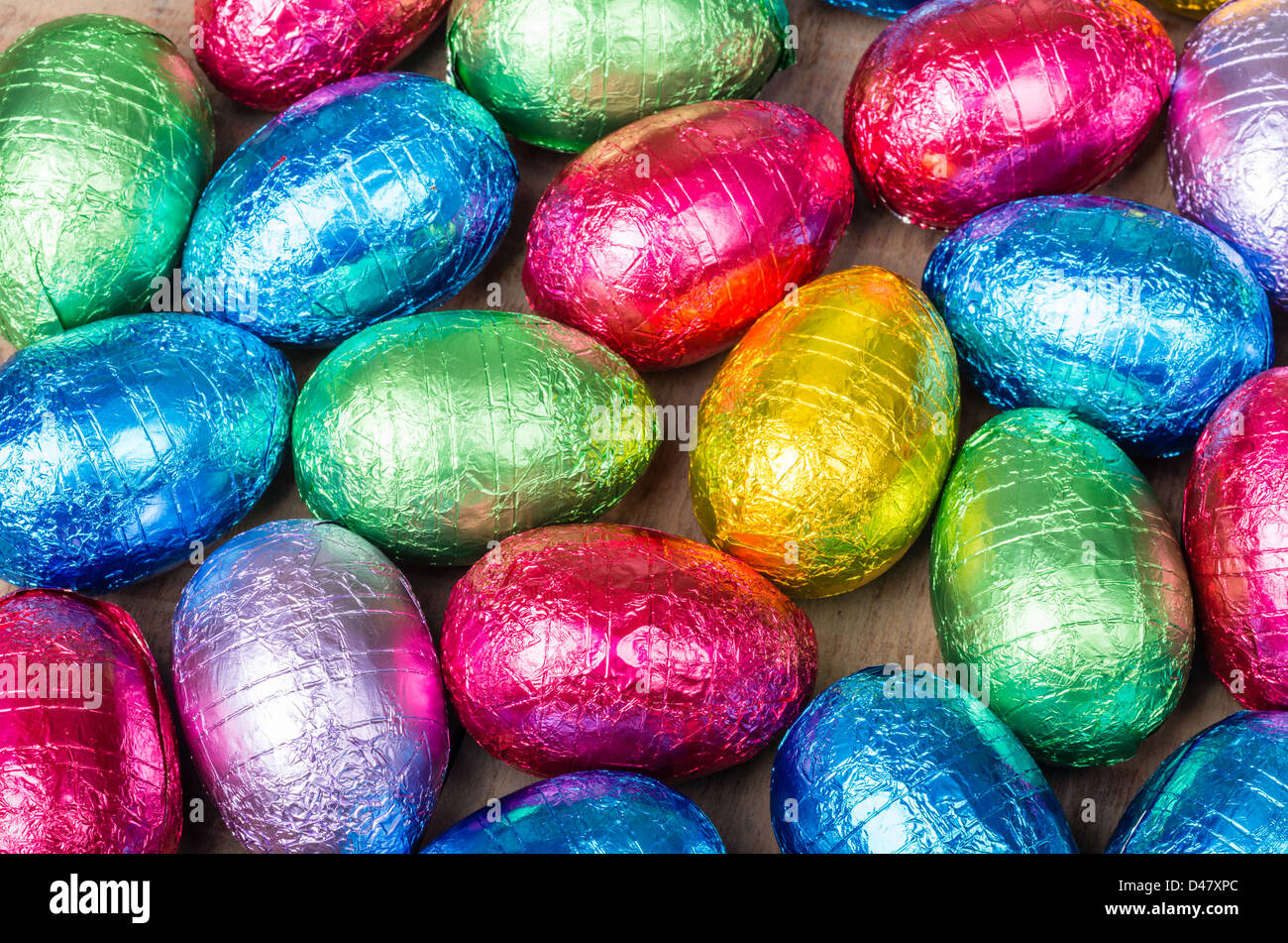 Display of foil wrapped colorful Easter eggs - Stock Image