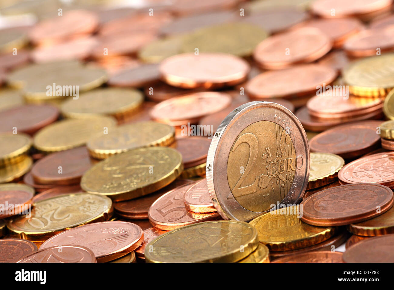 two EURO coin ina lot of EURO cent coins - Stock Image