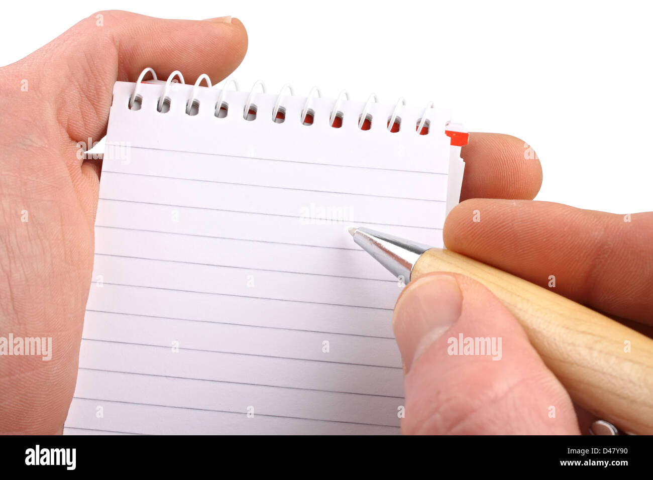 Hands with ballpen notepad on isolated white background. - Stock Image