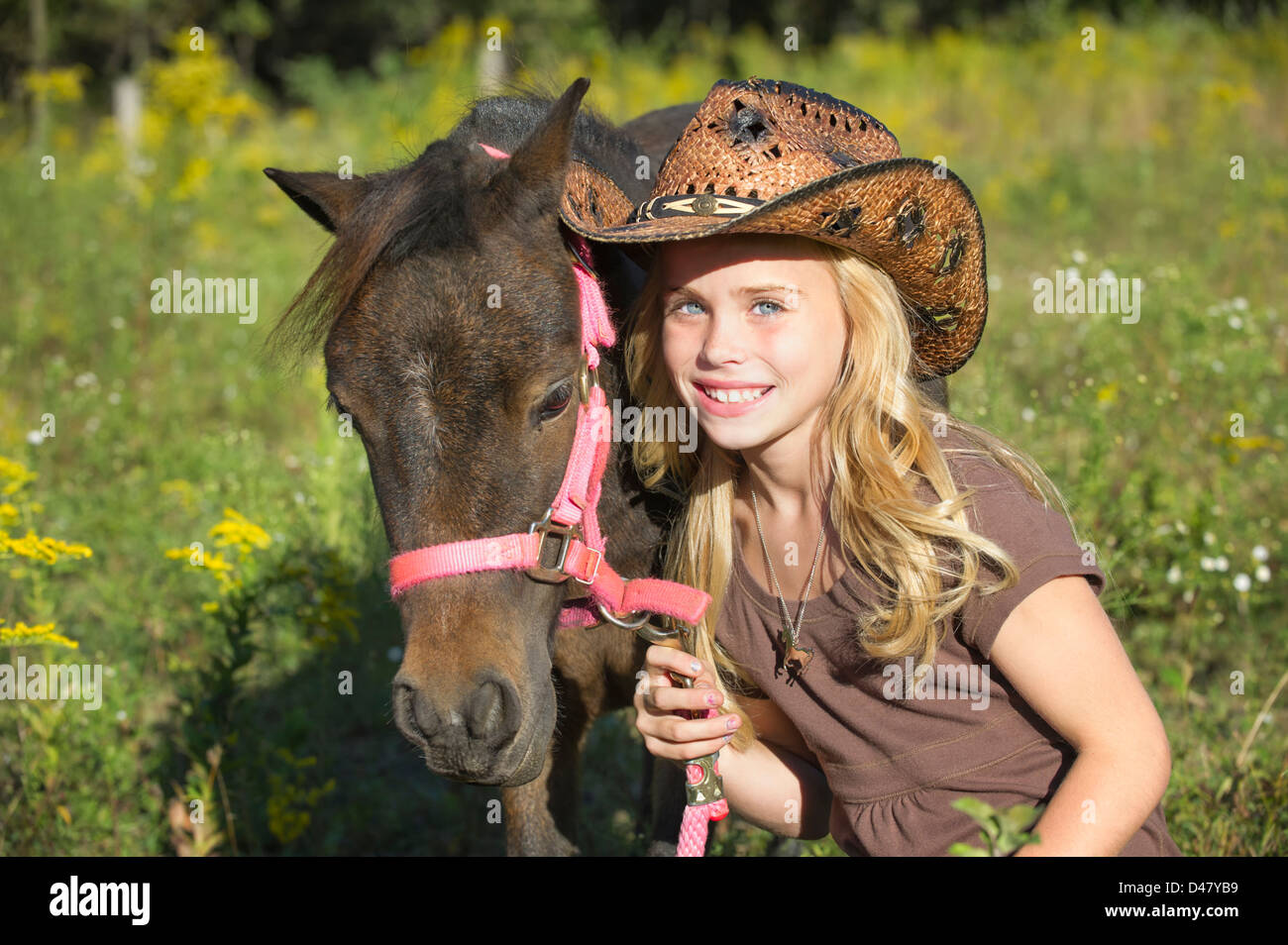 Miniature Horse And Child Stock Photos   Miniature Horse And Child ... 8b8dc69311f4