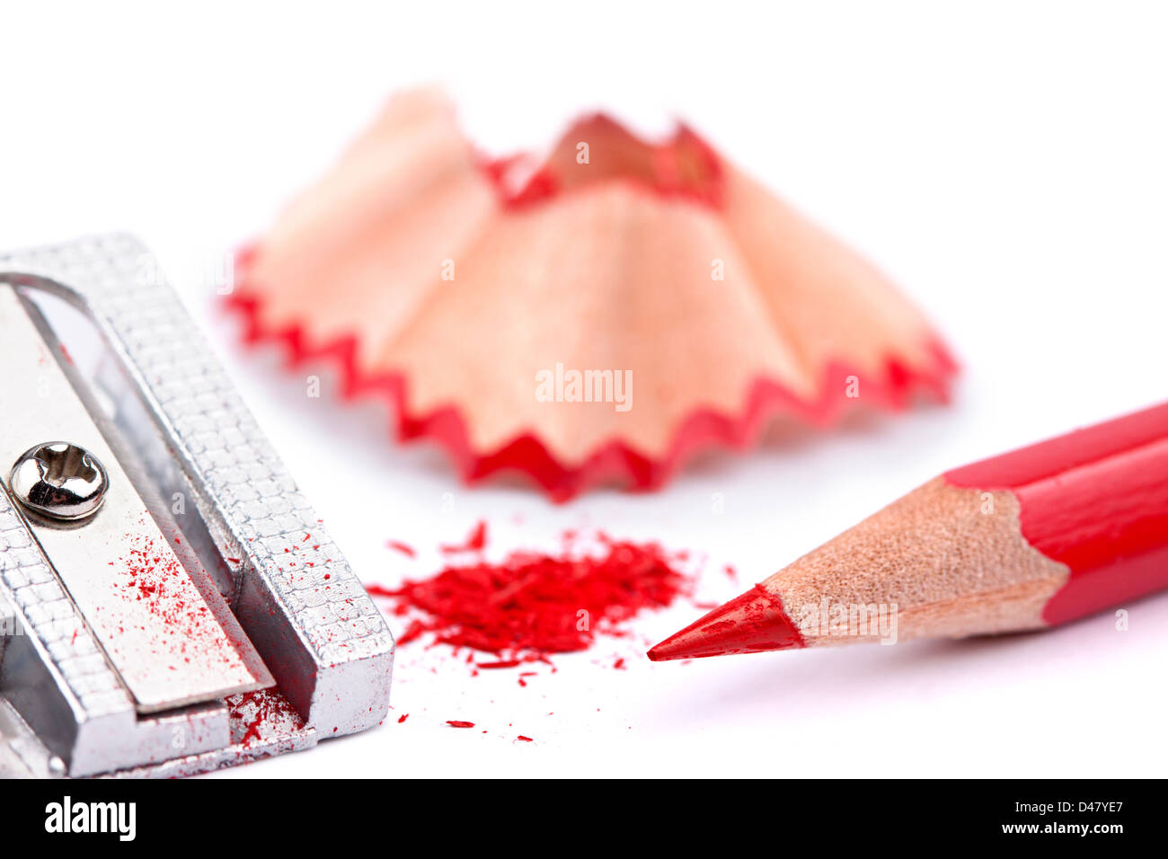 red pencil and sharpener on white background - Stock Image