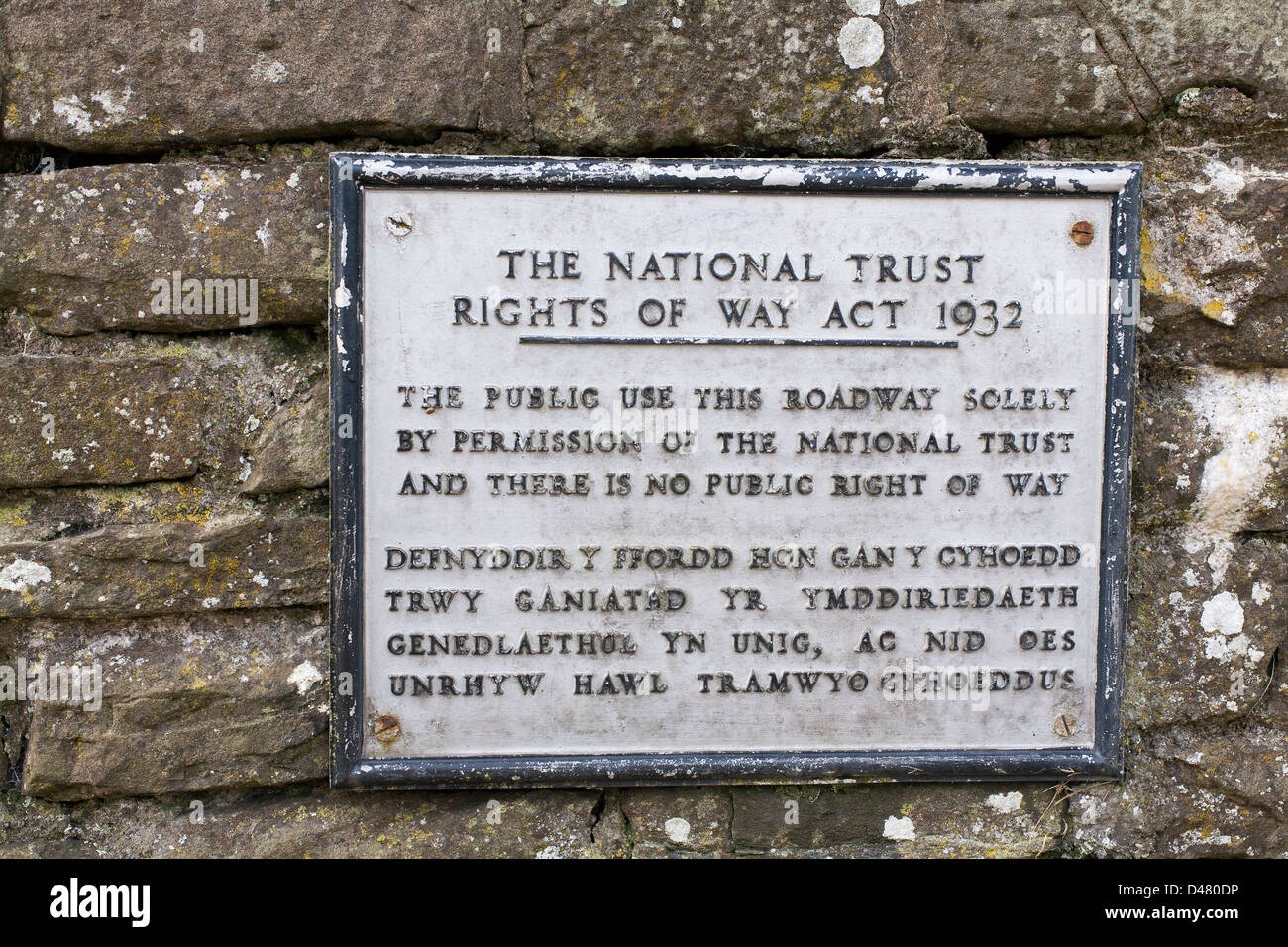 A plaque states the National Trust rights of way act 1932 in English and Welsh on a wall in Conwy, North Wales - Stock Image