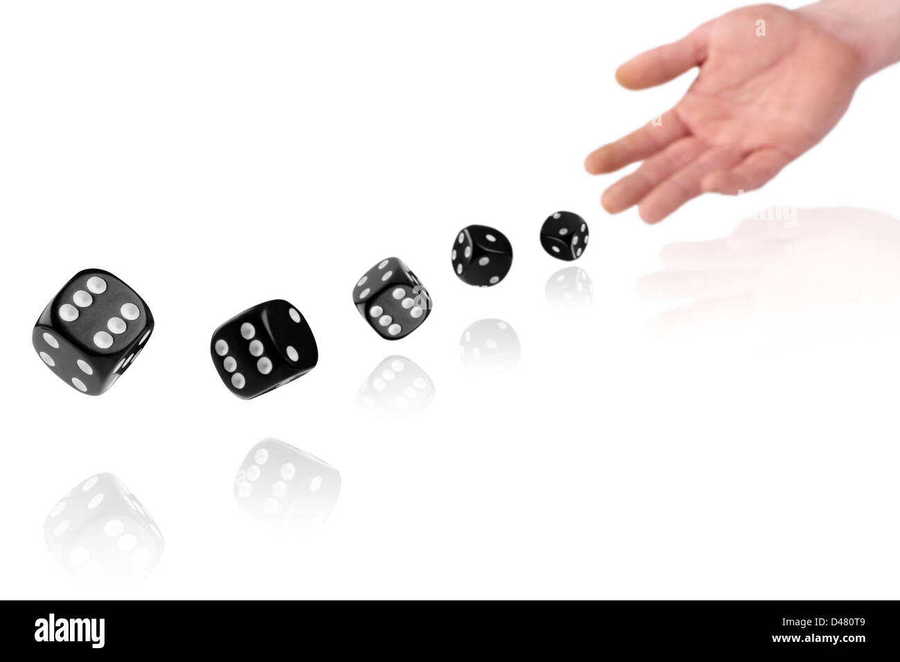 hand throwing dices on white background Stock Photo