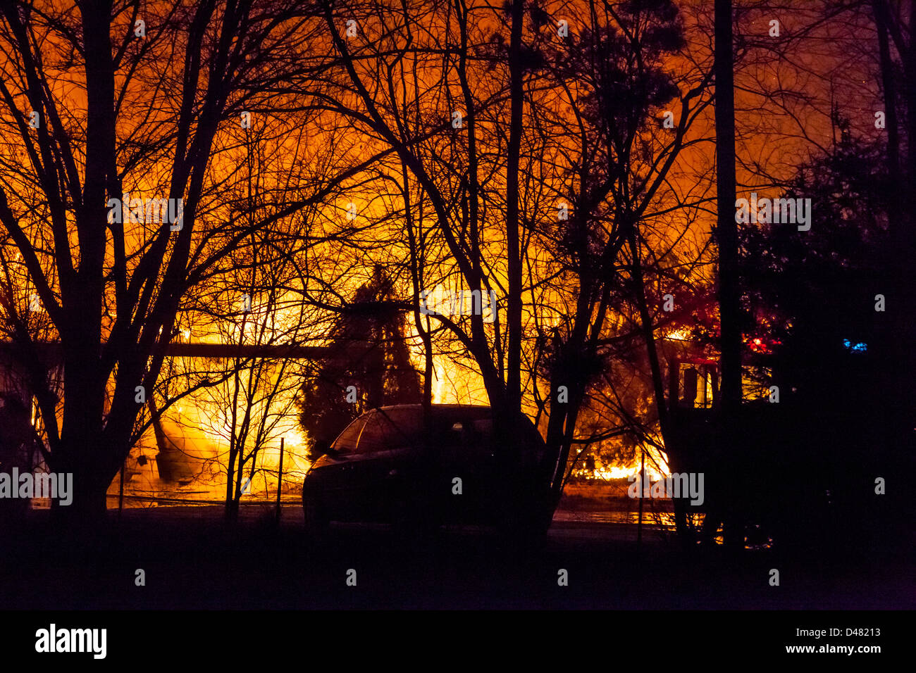 An out of control house fire lights up the night sky in Fernley Nevada - Stock Image