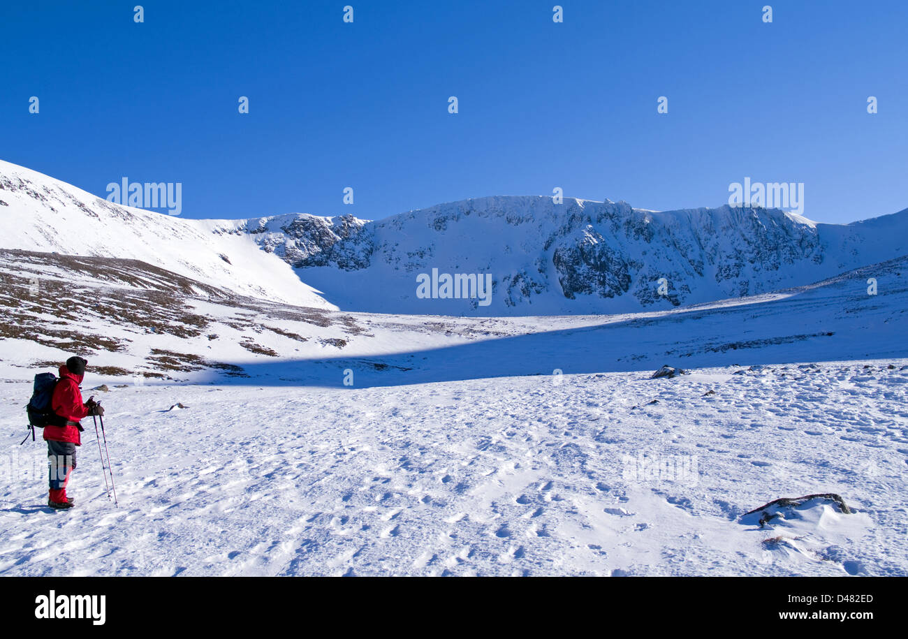 Hillwalker approaching Coire an t-Sneachda, Northern Corries, Cairngorms National Park, Scottish Highlands, winter, - Stock Image