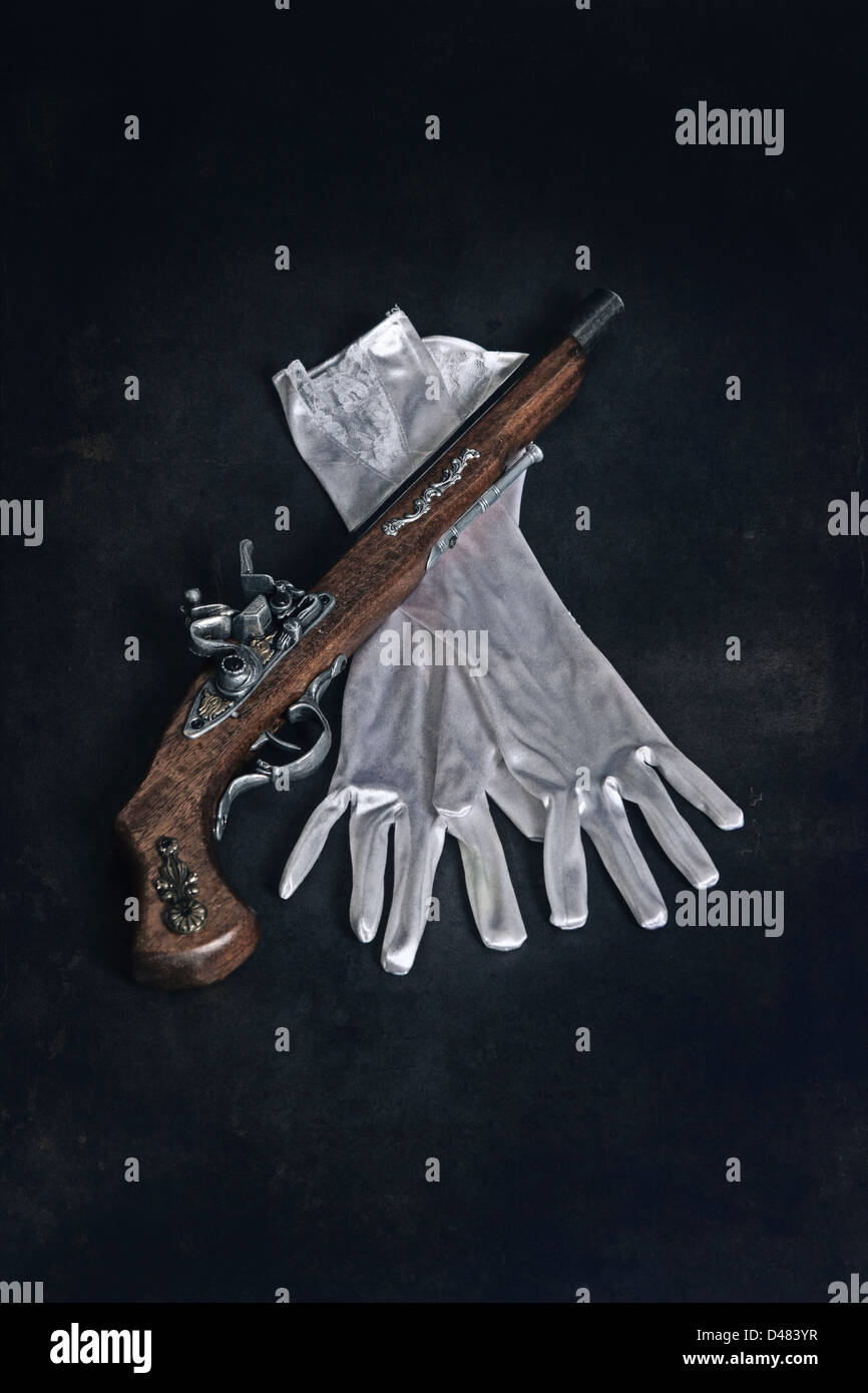an old military rifle with white gloves - Stock Image