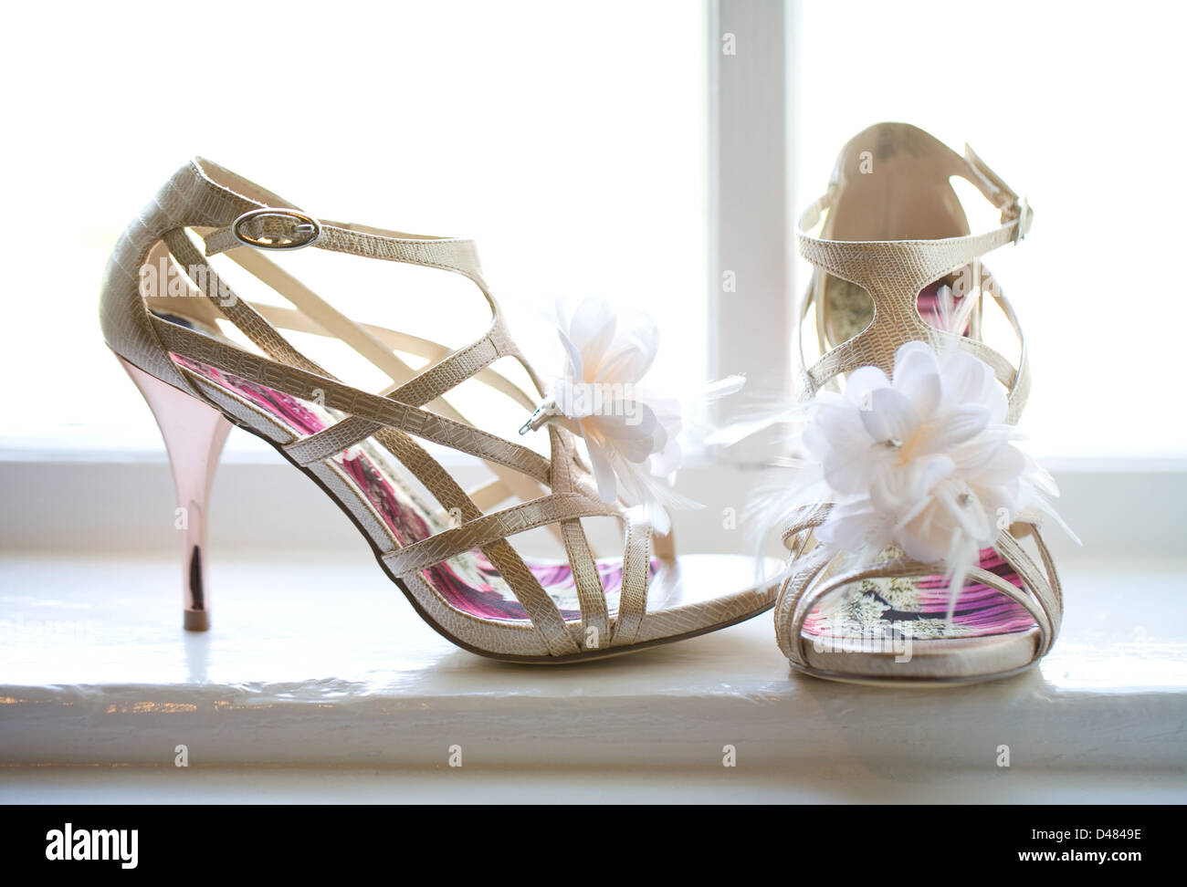 A Brides High Heels Ornate With Flowers And Feathers Sit In A