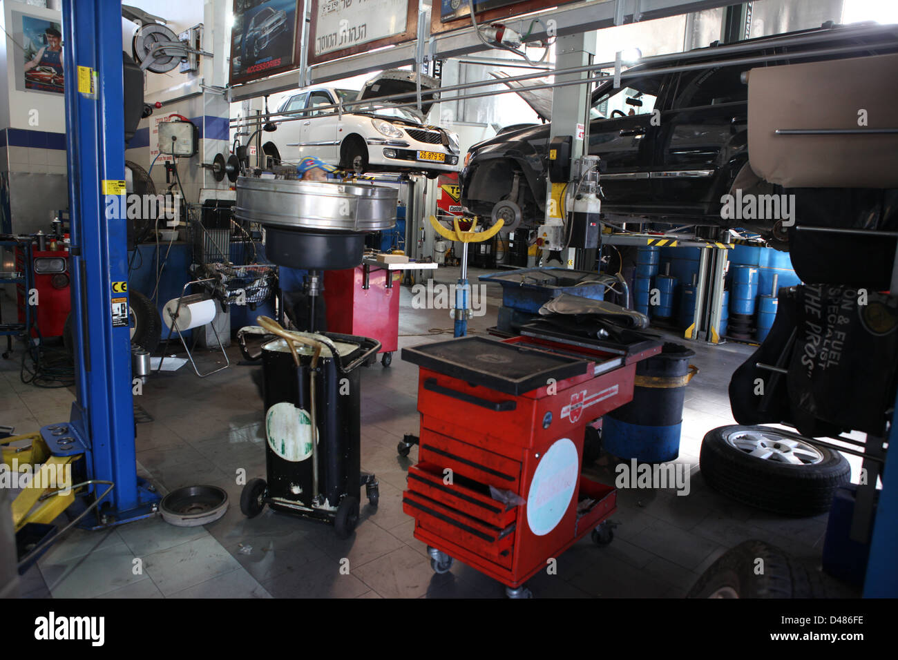 Car being serviced at a repair shop - Stock Image