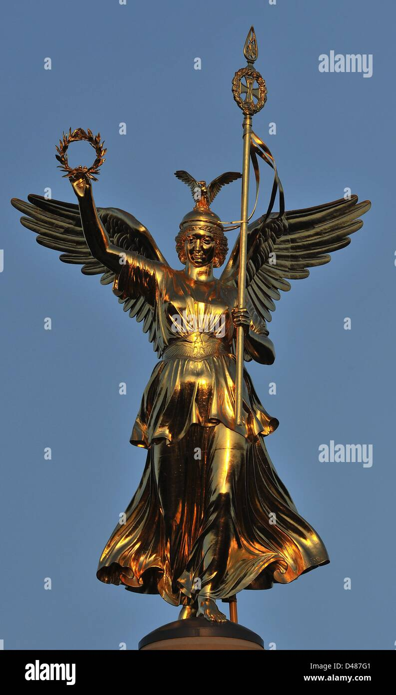 The so-called 'Goldelse' (lit. golden lizzy) stands tall on top of the Berlin Victory Column in front of - Stock Image