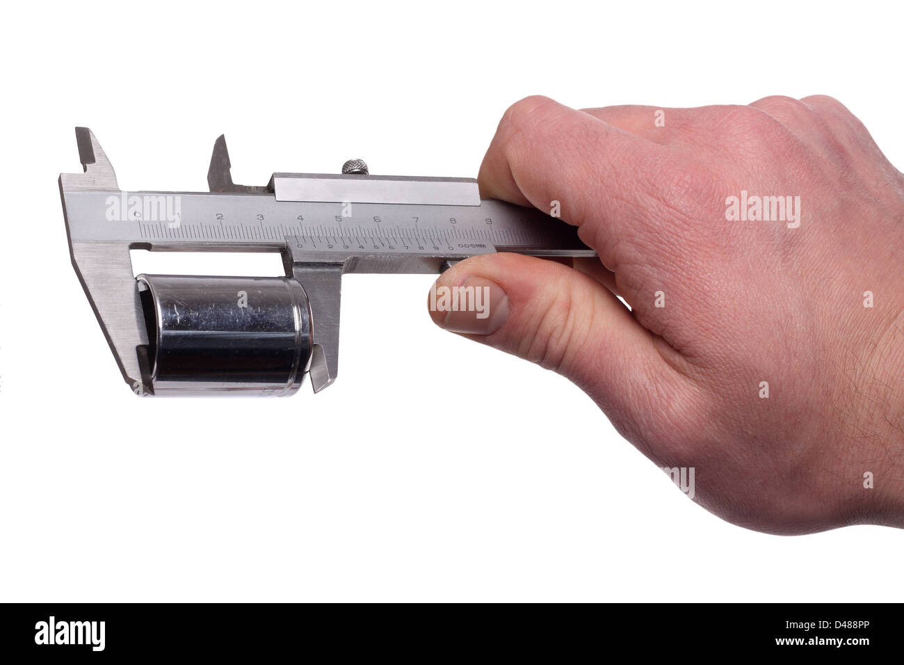 Measuring a metall objekt with a caliper. - Stock Image