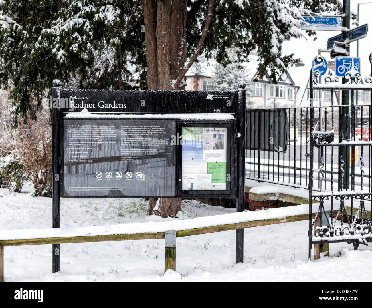 Snow covered Entrance and information board  in Winter- Radnor Gardens, Strawberry Hill,Greater London,UK - Stock Image