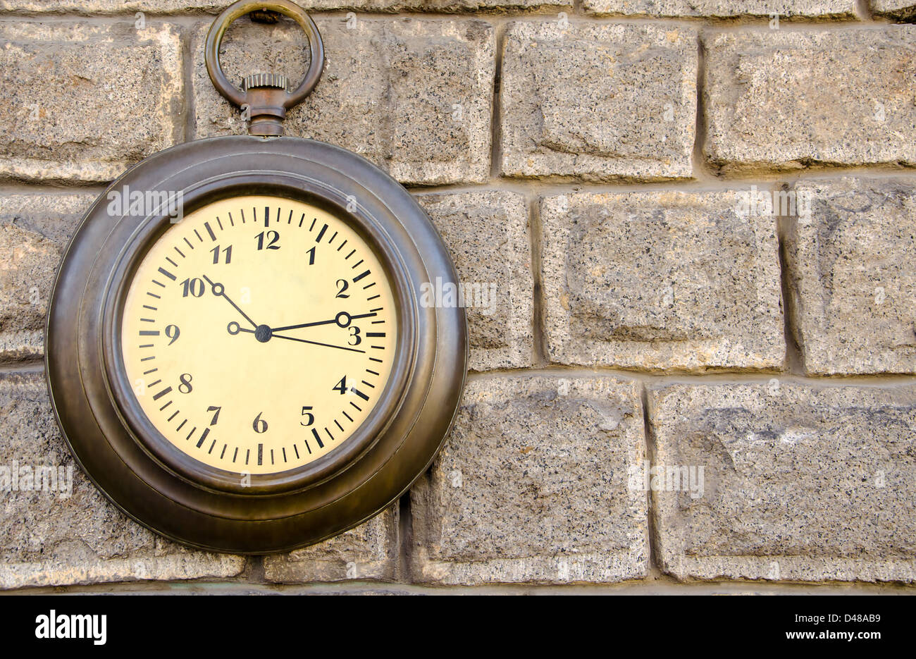 Old metal clock on a stone wall, Old Town, Plovdiv, Bulgaria, Balkans, Eastern Europe - Stock Image