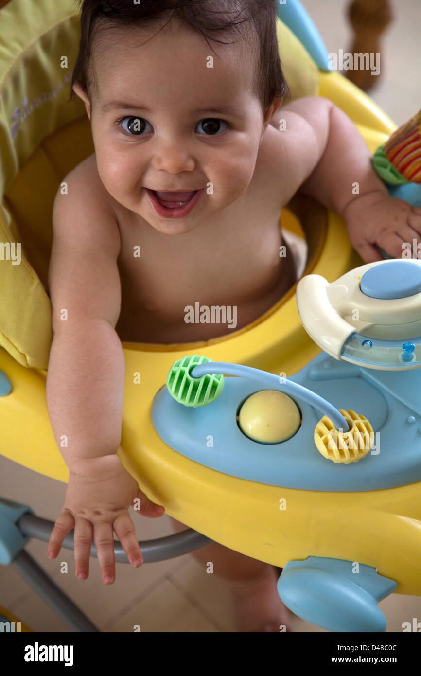 Baby Boy In Baby Walker Stock Photos & Baby Boy In Baby Walker Stock ...