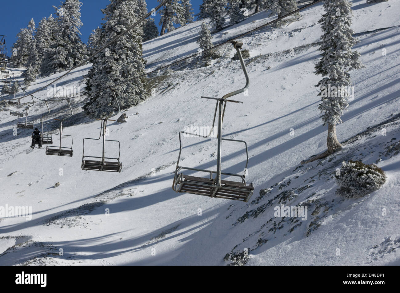 single rider on chair lift at mt baldy ski resort stock. Black Bedroom Furniture Sets. Home Design Ideas