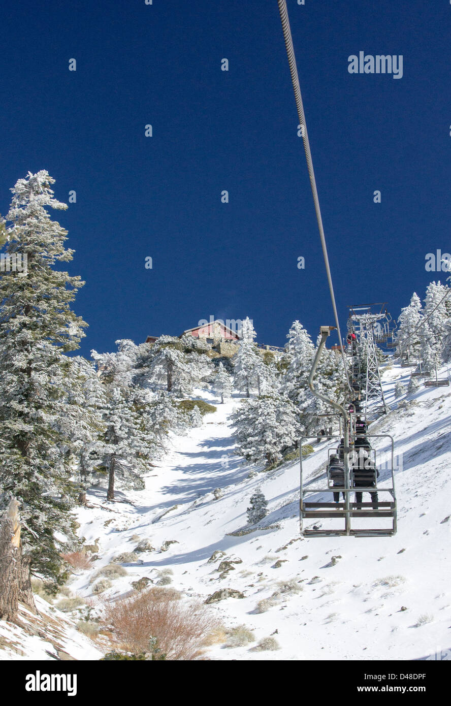 riders on the chair lift at mt. baldy ski resort stock photo