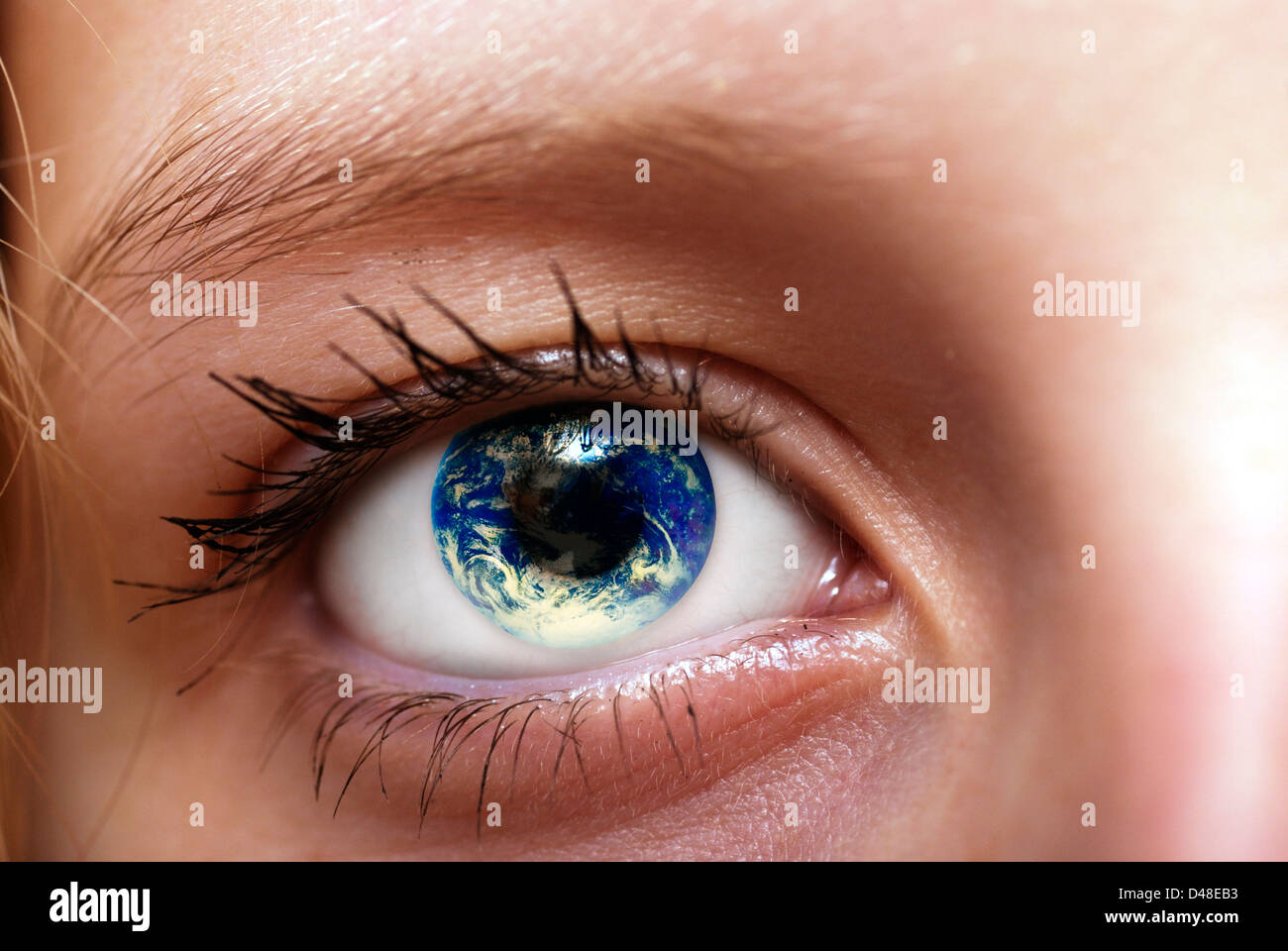 earth inside the eye of a girl. Sustainability, ecology awareness and environment preservation for future generations - Stock Image