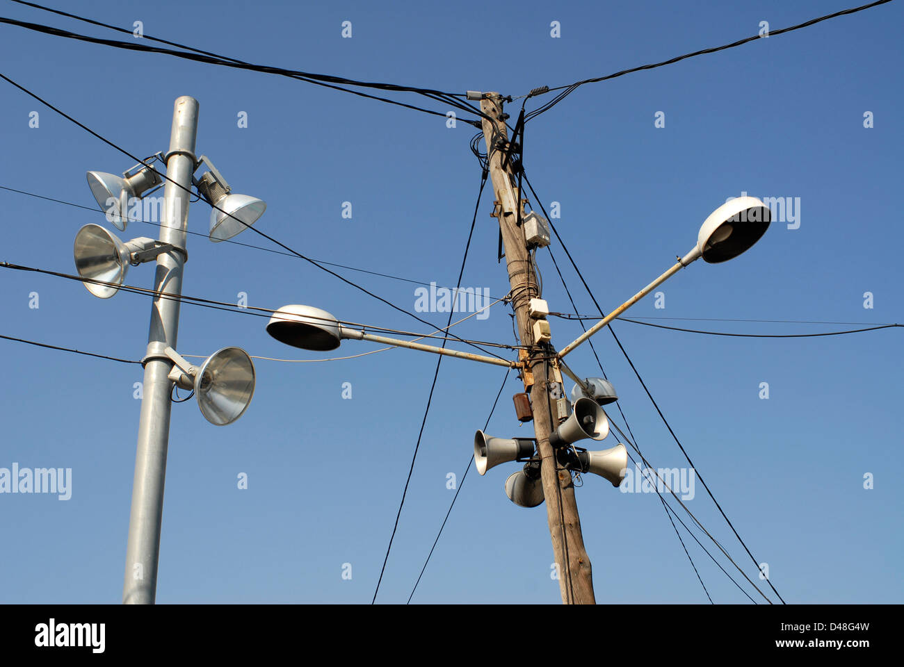 streetlights obsolete lampposts obsolete streetlamps old and modern - Stock Image