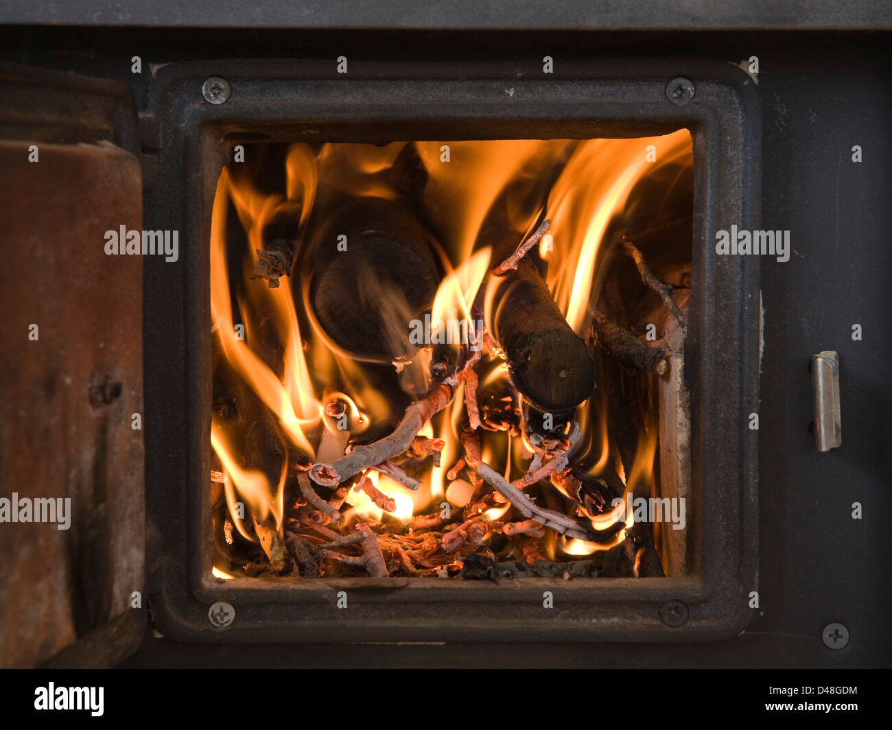 Woodstove, inside detail of fire-box - Stock Image