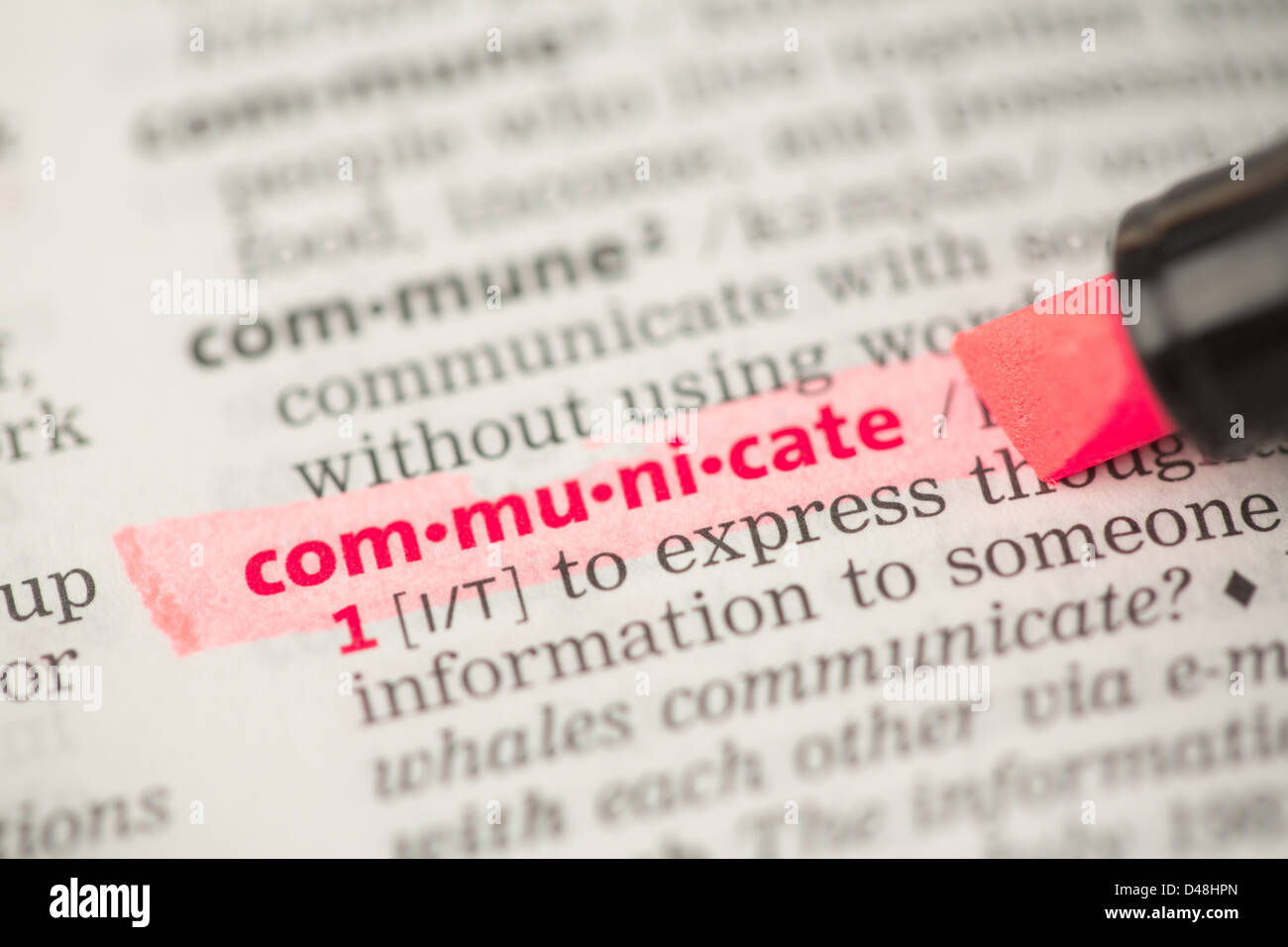 Communicate definition highlighted in red - Stock Image