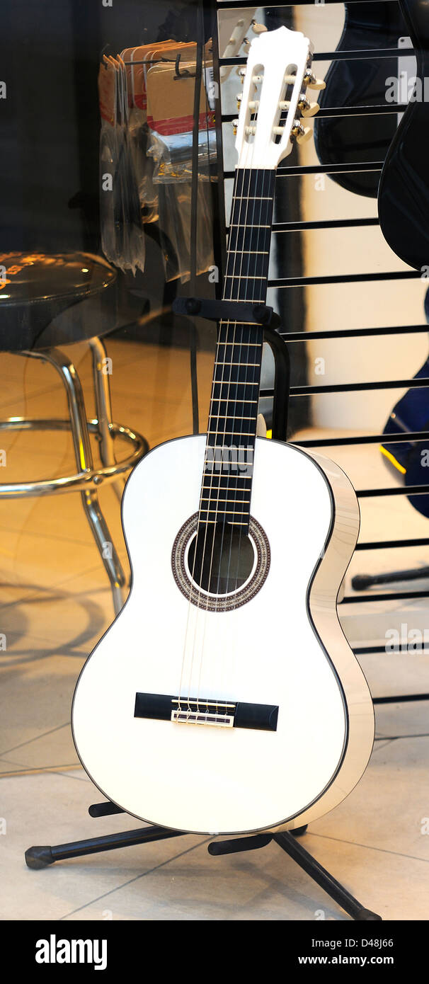Acoustic six strings guitar in a musical shop - Stock Image