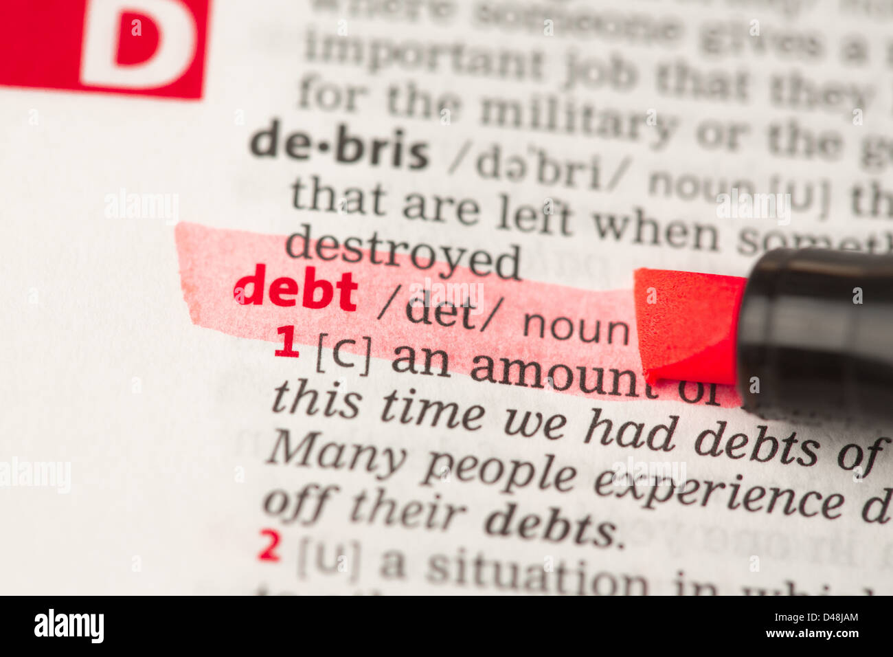 Debt definition highlighted in red - Stock Image