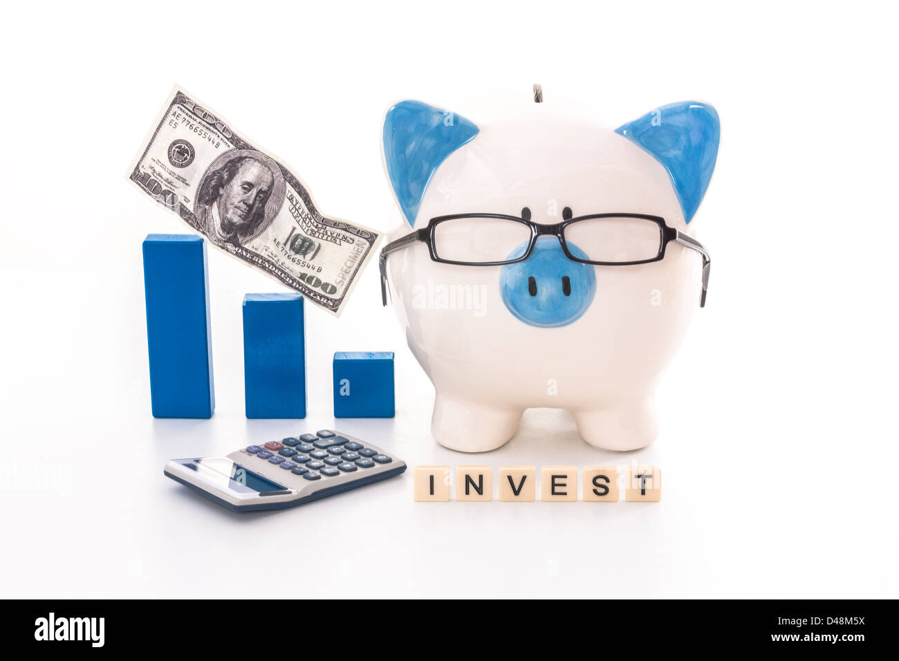 Blue and white piggy bank wearing glasses with invest message - Stock Image
