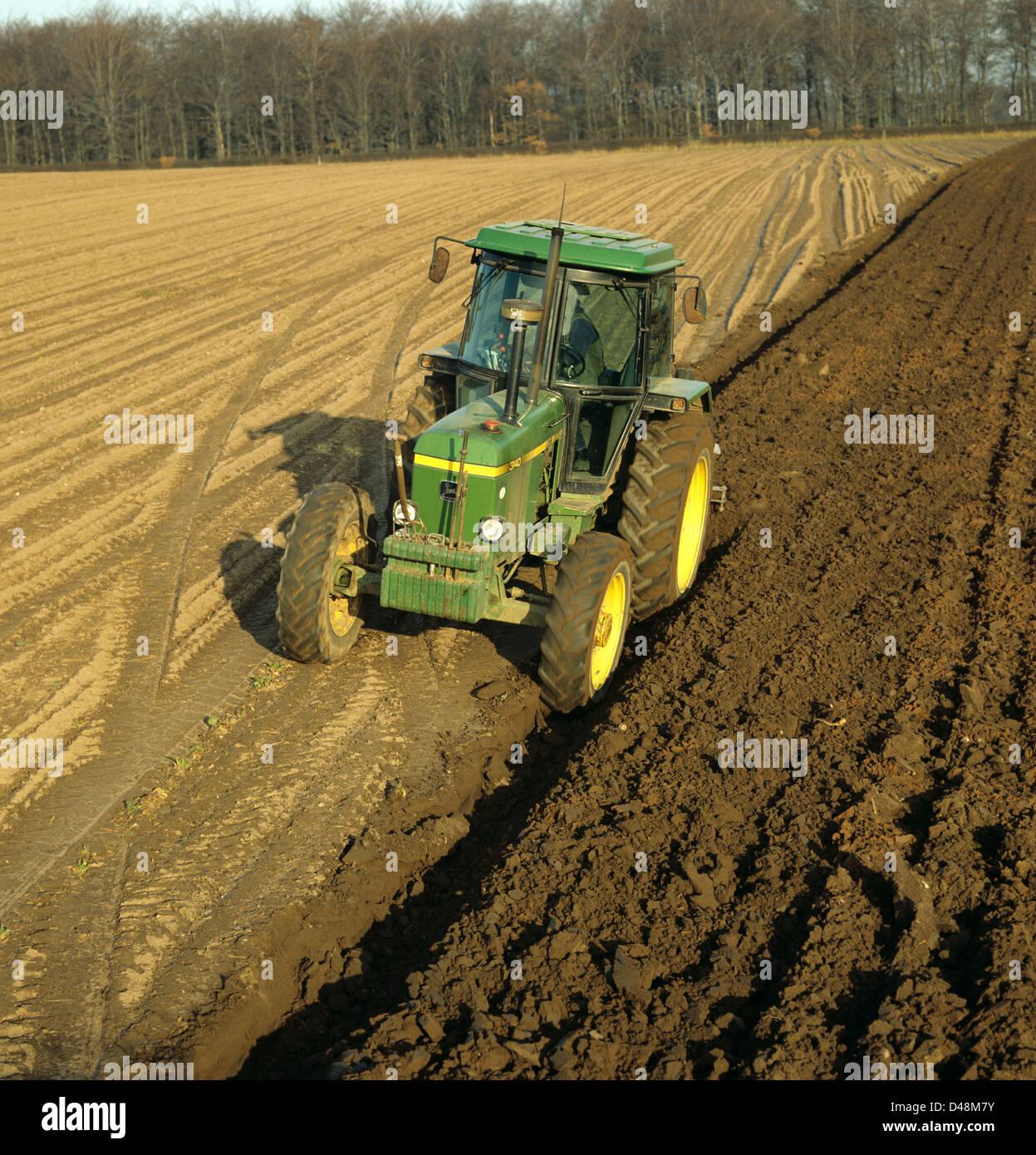 The Oldest John Deere : An old john deere tractor ploughing a field in winter