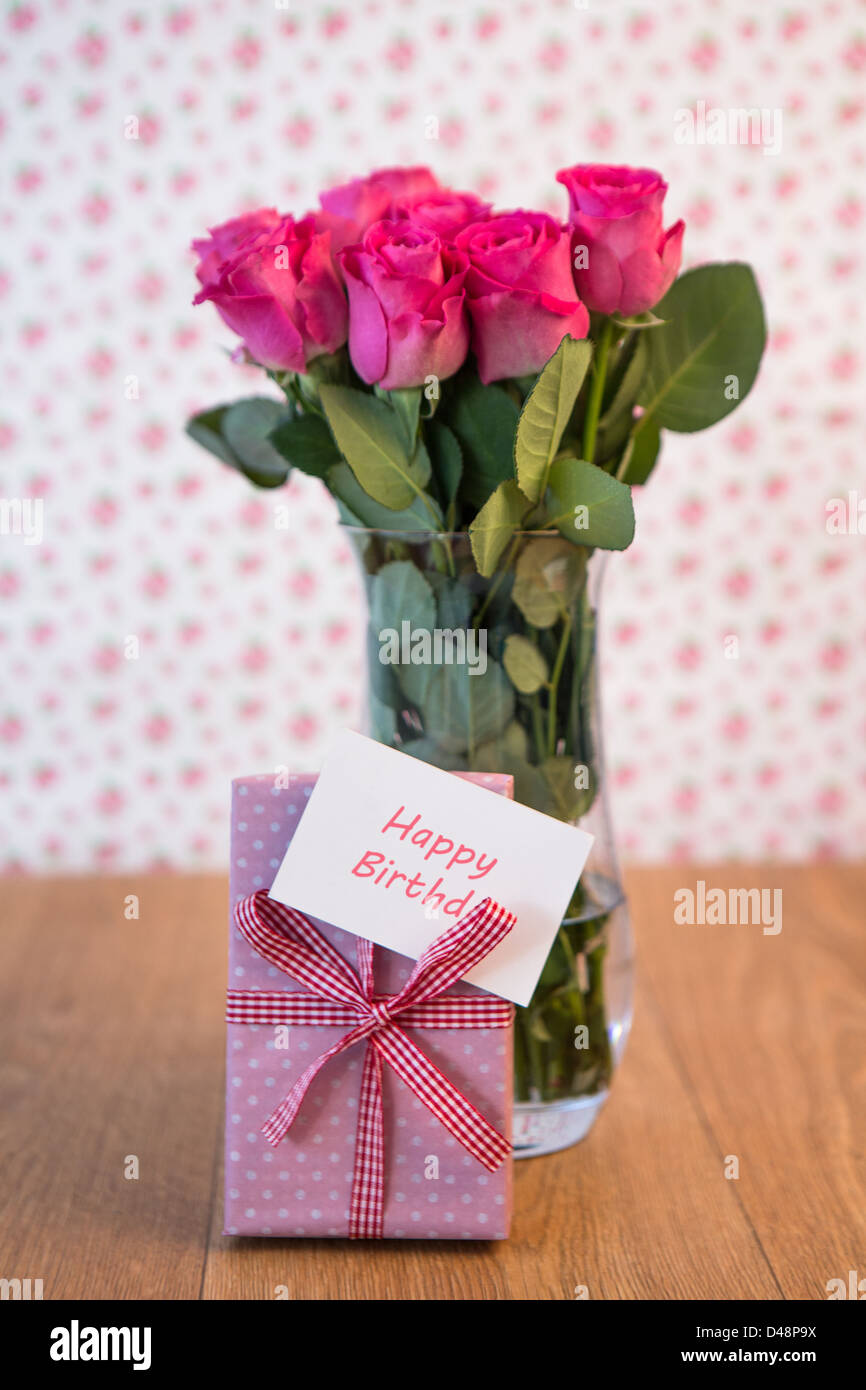 Happy birthday card red roses stock photos happy birthday card red bunch of pink roses in vase with pink gift leaning against it and happy birthday card izmirmasajfo