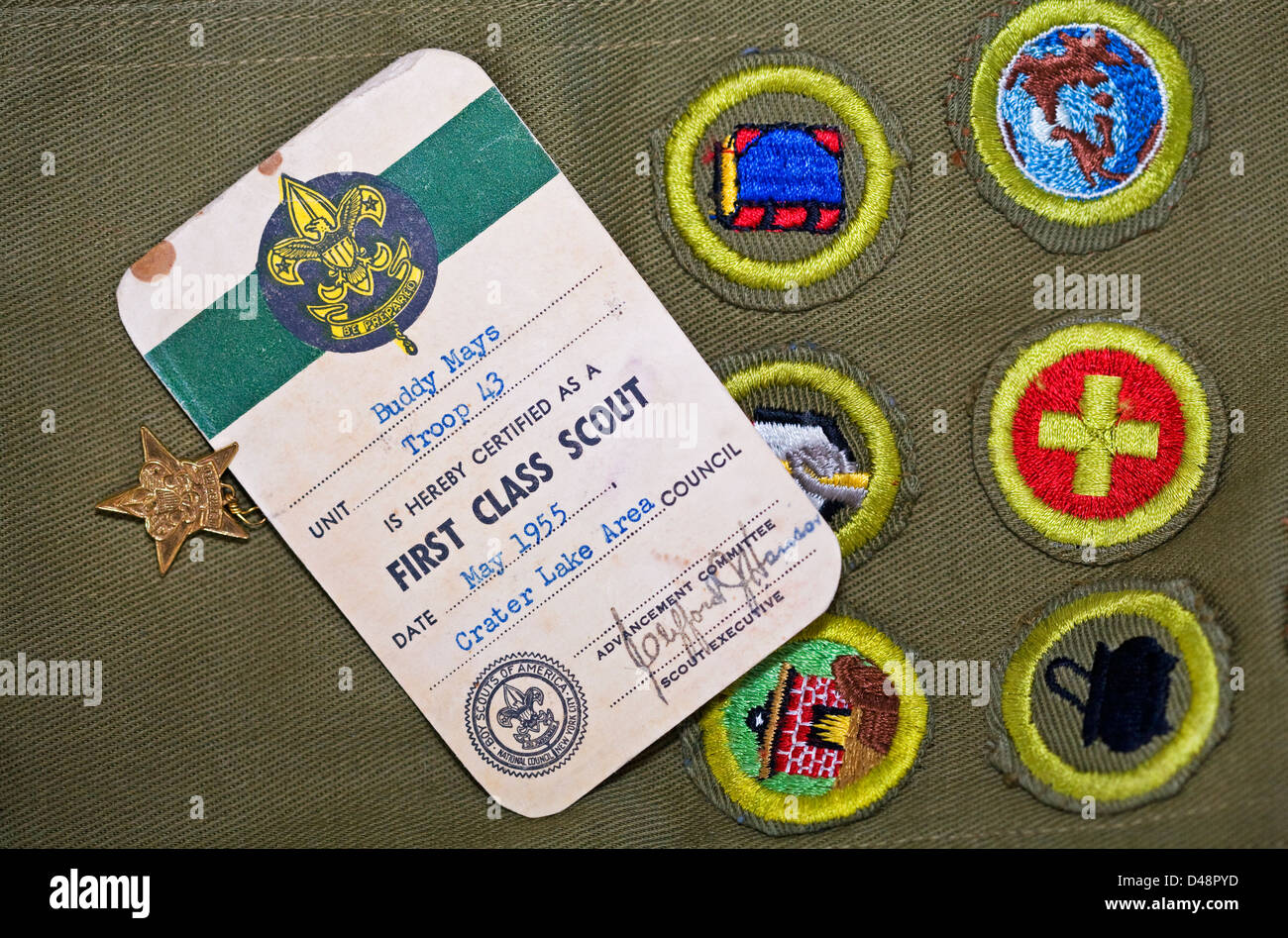 A Boy Scout sash with merit badges and First Class and Star Scout pins, from 1955. - Stock Image