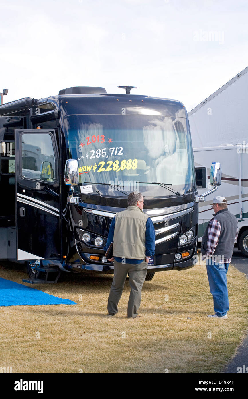 Two men examine a very expensive motorhome at a sportsman's show in Redmond, Oregon - Stock Image