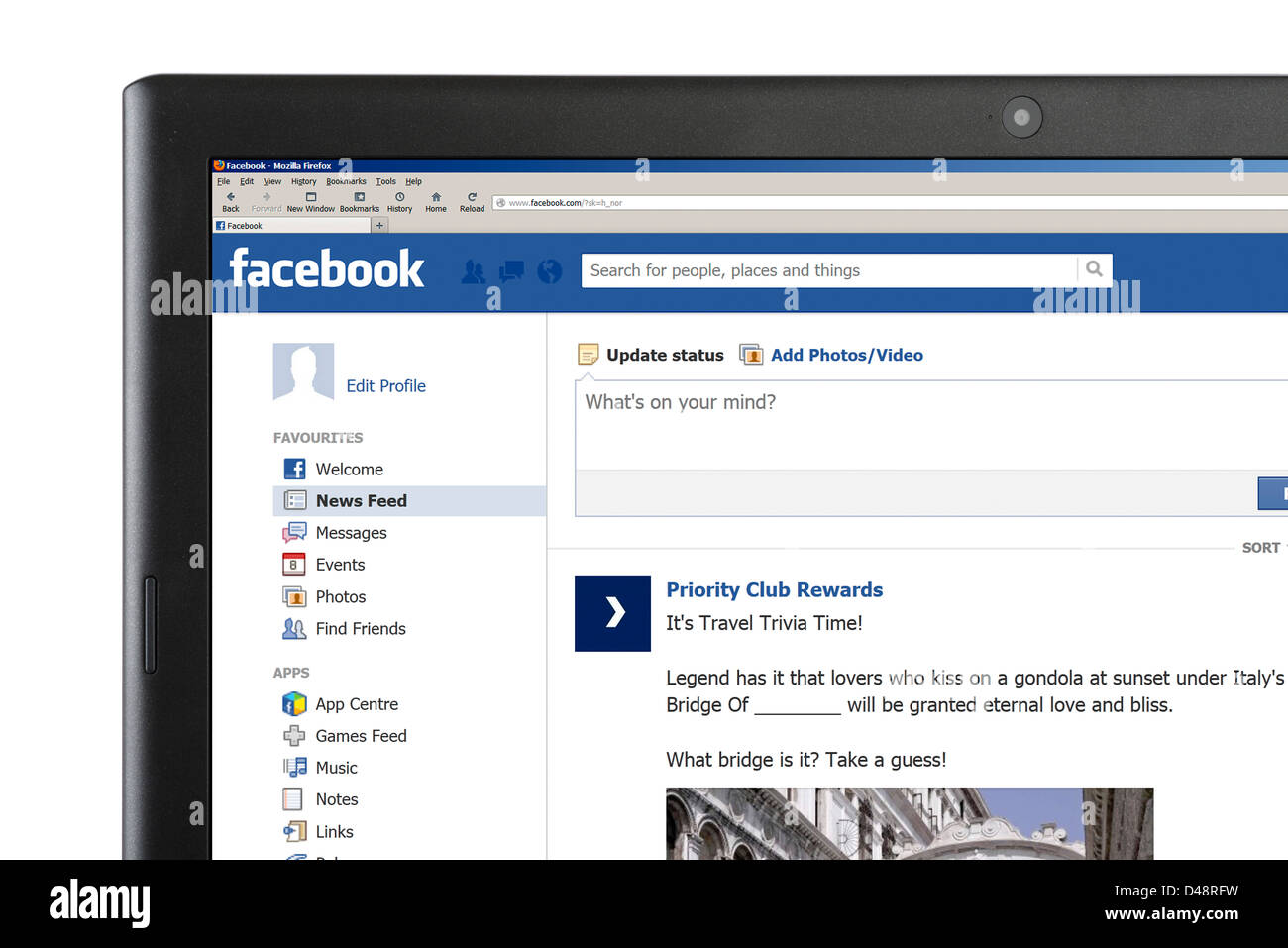 The Facebook News Feed page on a laptop computer - Stock Image