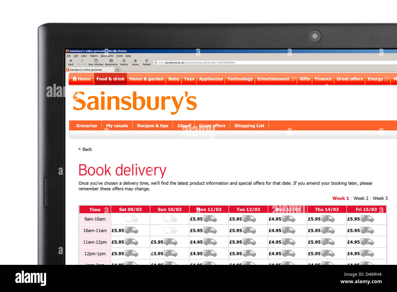 Booking a home delivery online on the Sainsbury's shopping website, UK - Stock Image