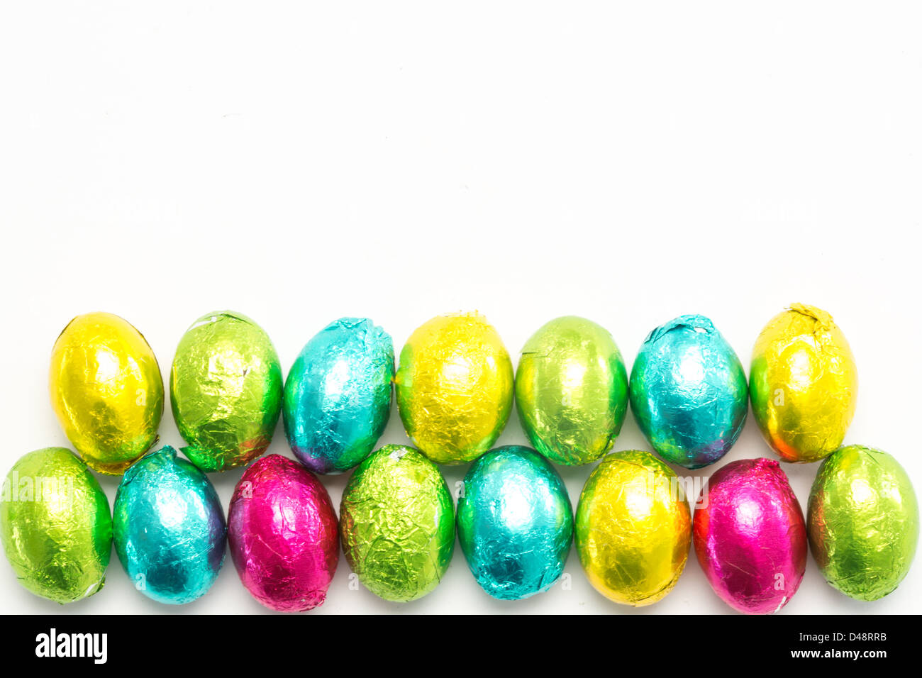 Colourful foil wrapped easter eggs - Stock Image