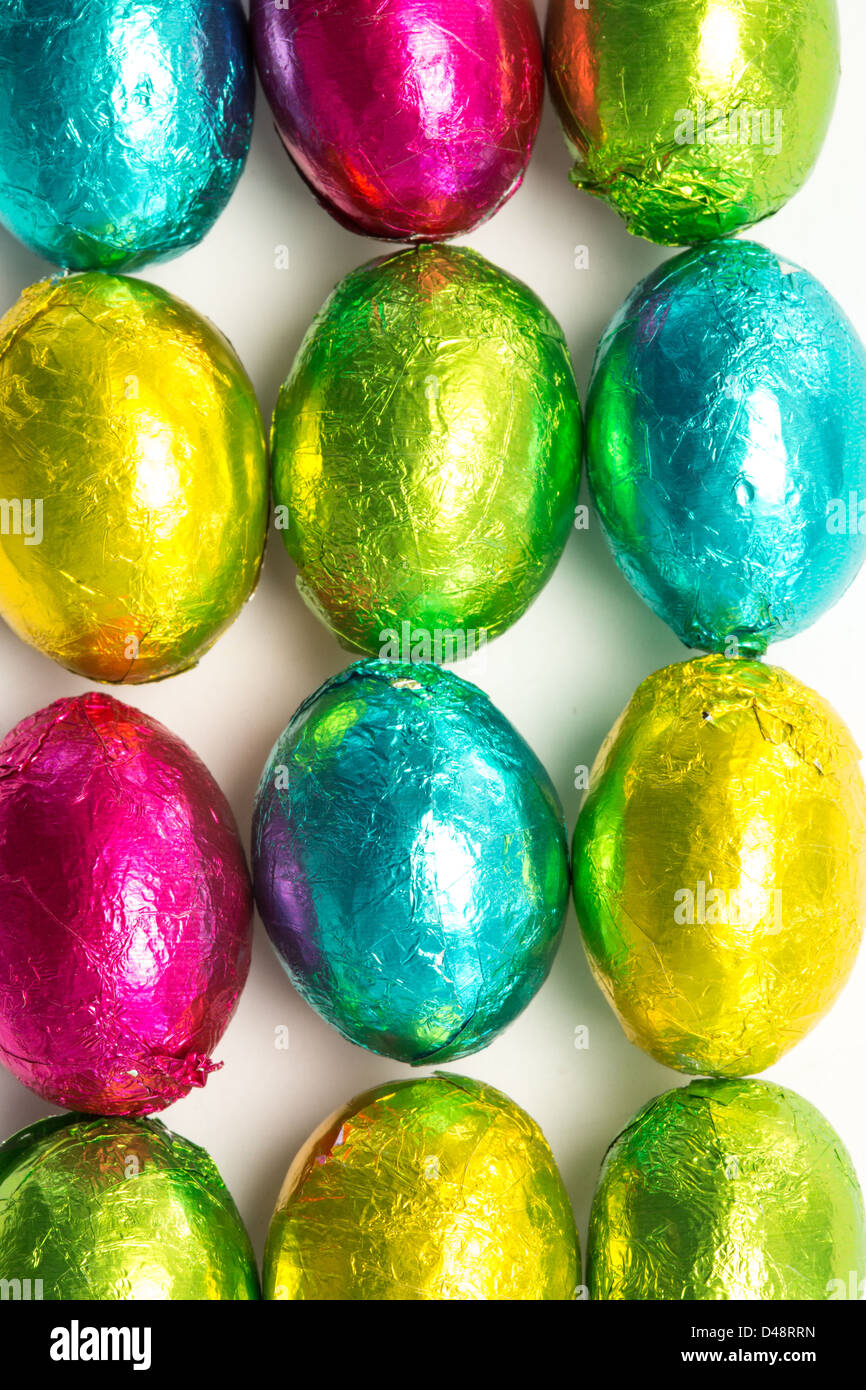 Colourful foil wrapped easter eggs overhead shot - Stock Image