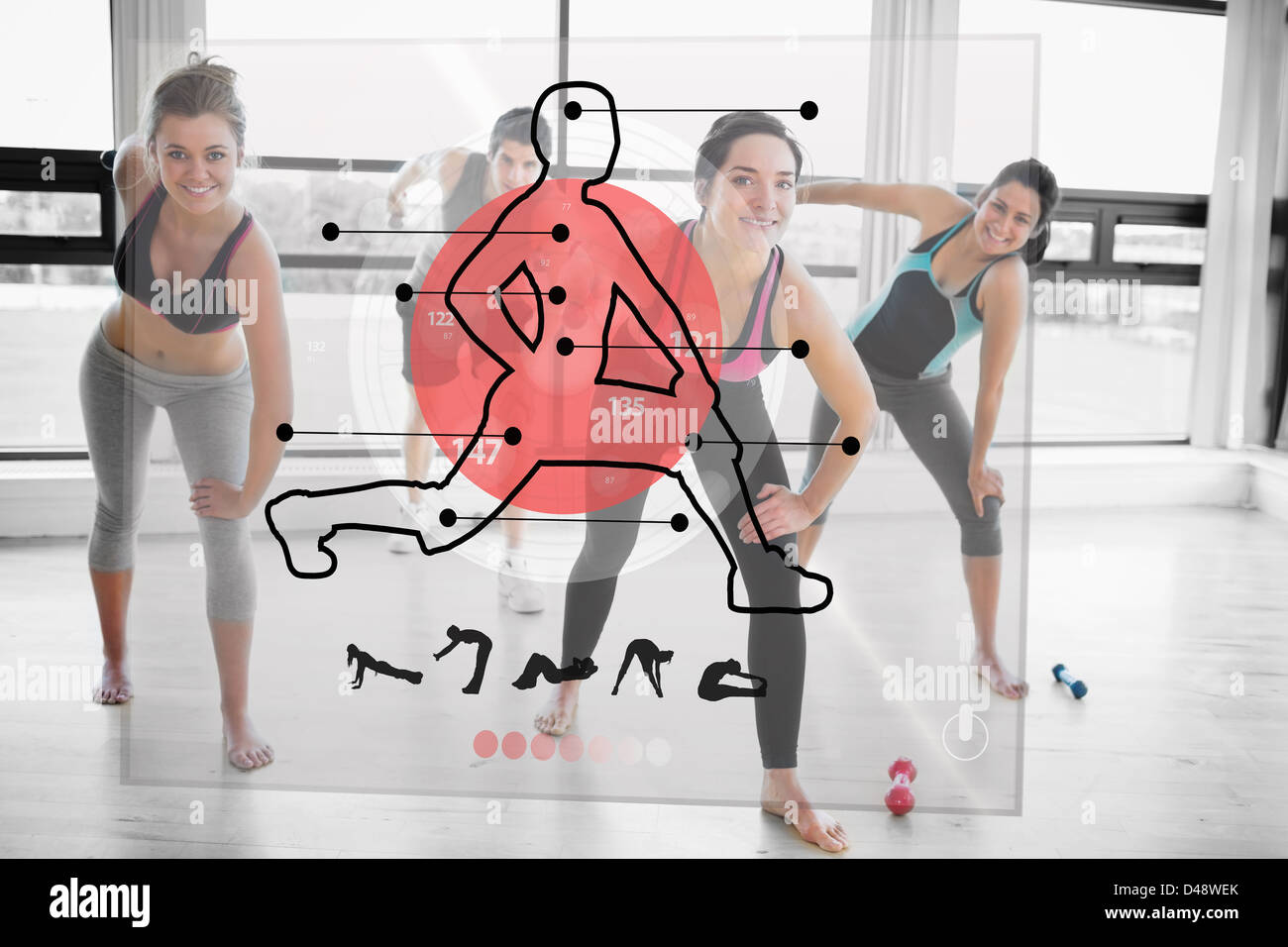Women doing exercise with futuristic red interface demonstration - Stock Image