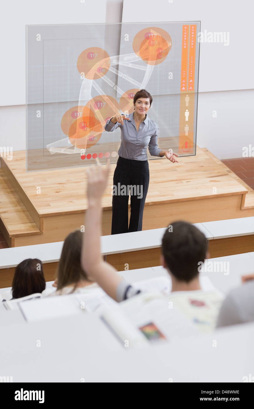 Teacher in front of futuristic interface university college student - Stock Image