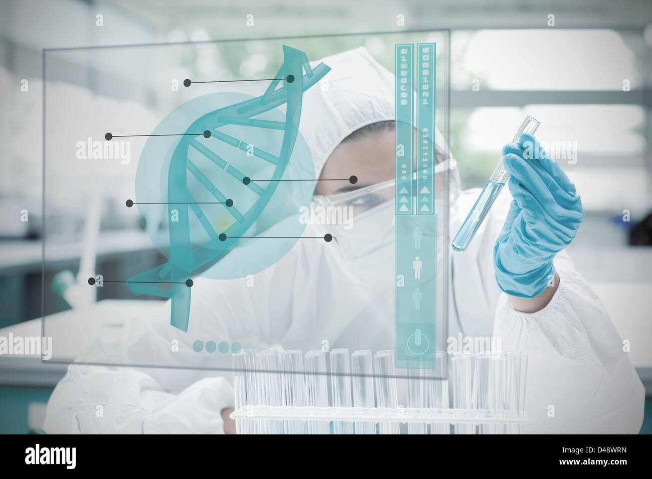 Chemist working cautiously with blue liquid and futuristic interface - Stock Image