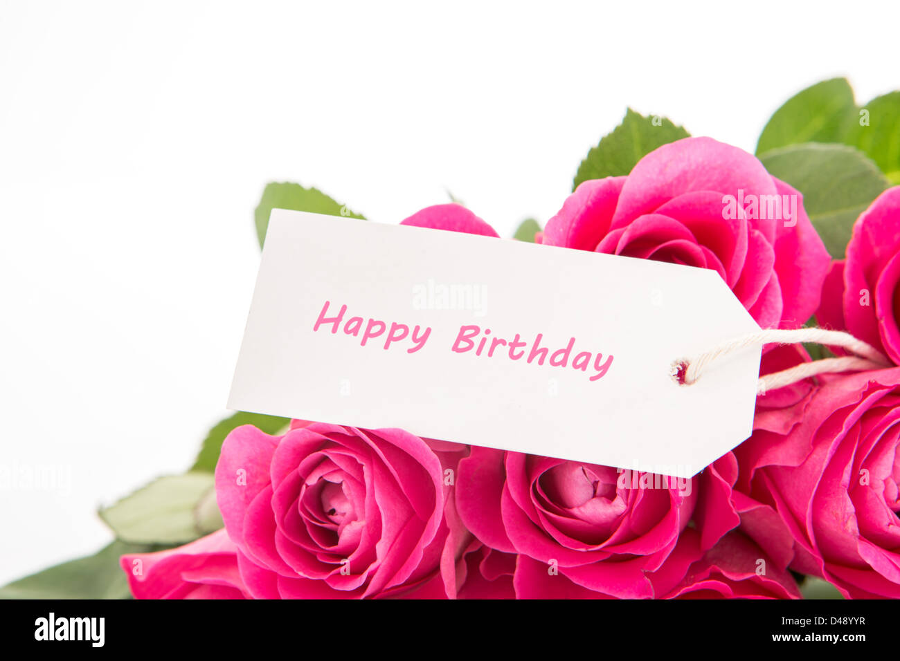 Close up of a beautiful bouquet of pink roses with a happy birthday close up of a beautiful bouquet of pink roses with a happy birthday card on a white background izmirmasajfo