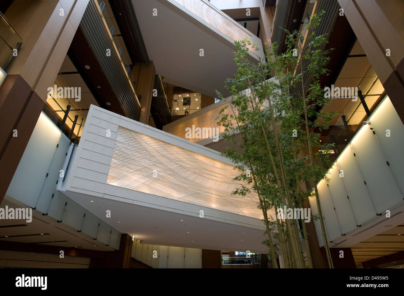 Multi-story shopping mall atrium at new, modern Tokyo Midtown, a mixed-use shopping, hotel and residential complex - Stock Image